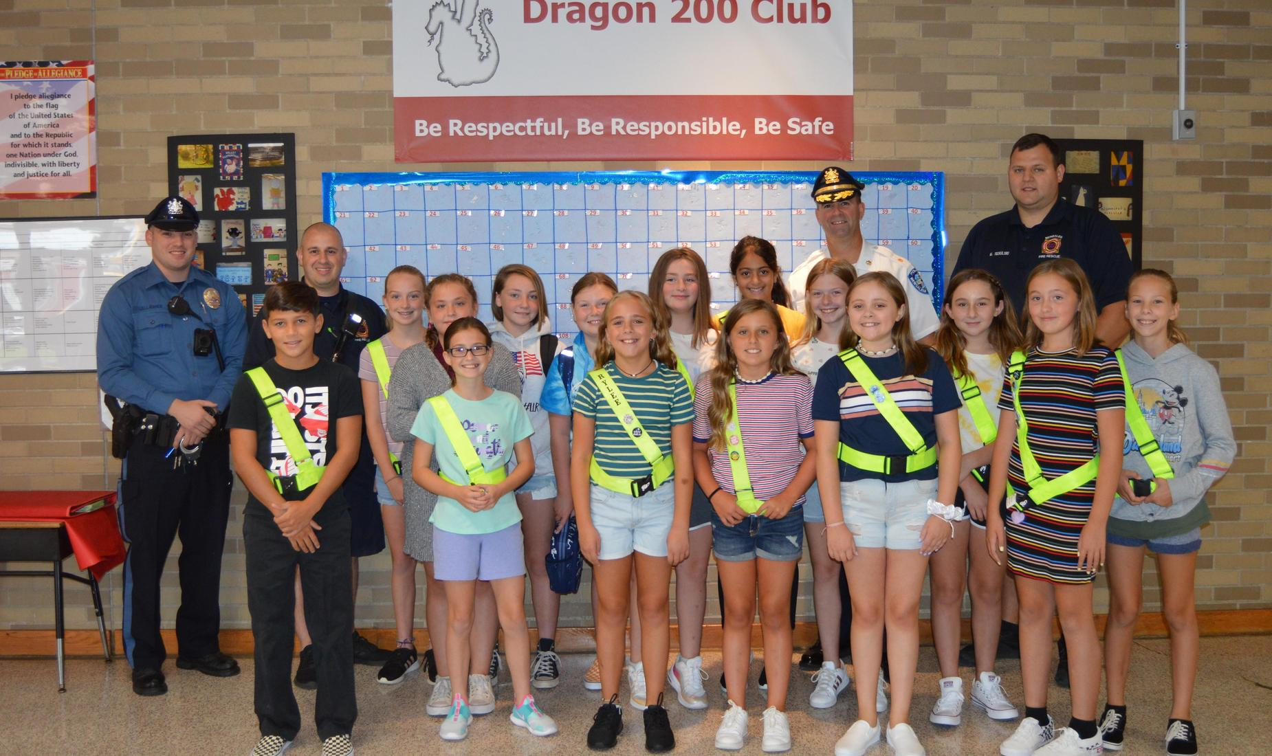 15 Safeties with their yellow belts pose on first day of school with 2 members of the Bensalem Police and Fire Rescue