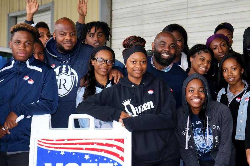 Students pose together after participating in early voting