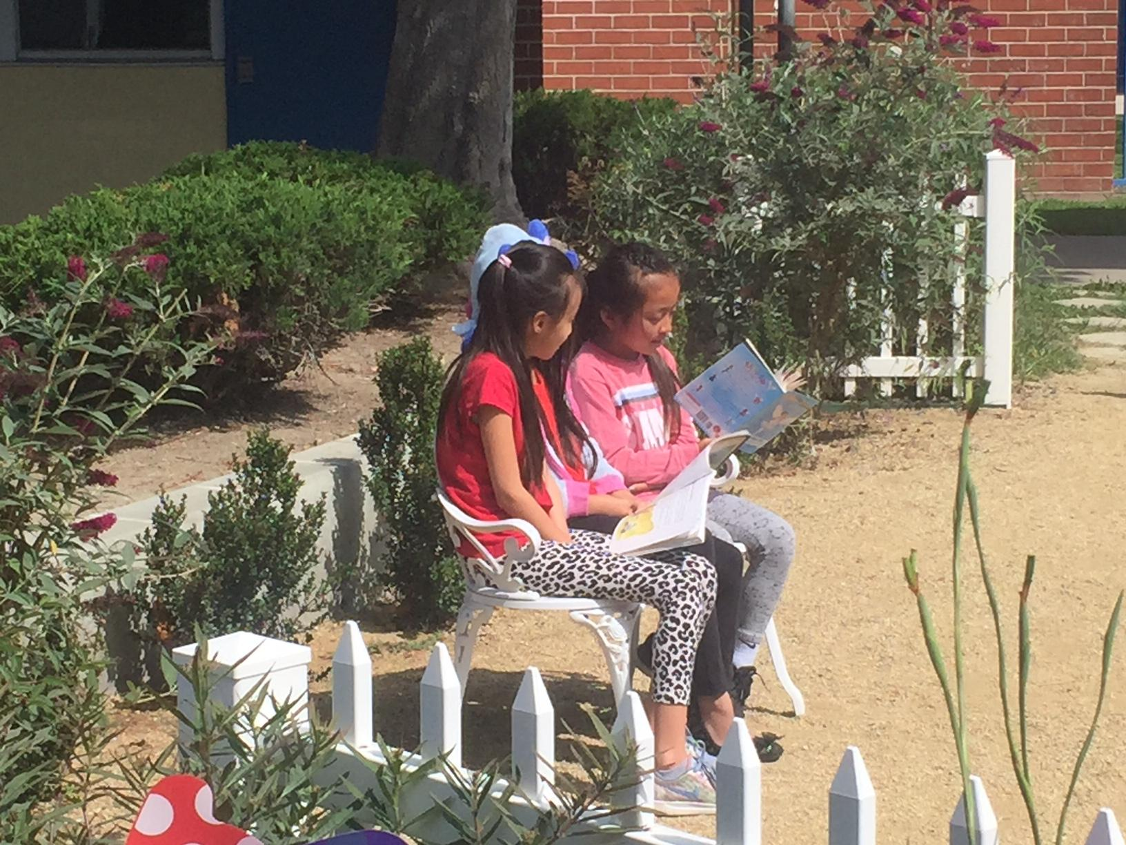 Two students reading in the Hayden Reading Garden
