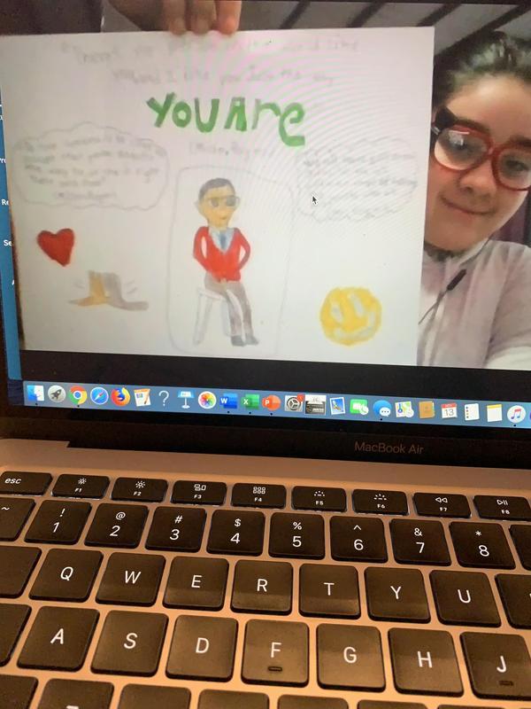 Makayla holding drawing