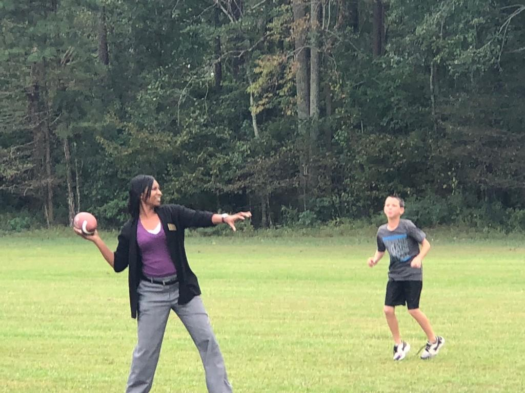 Mrs. Bennett throwing the ball