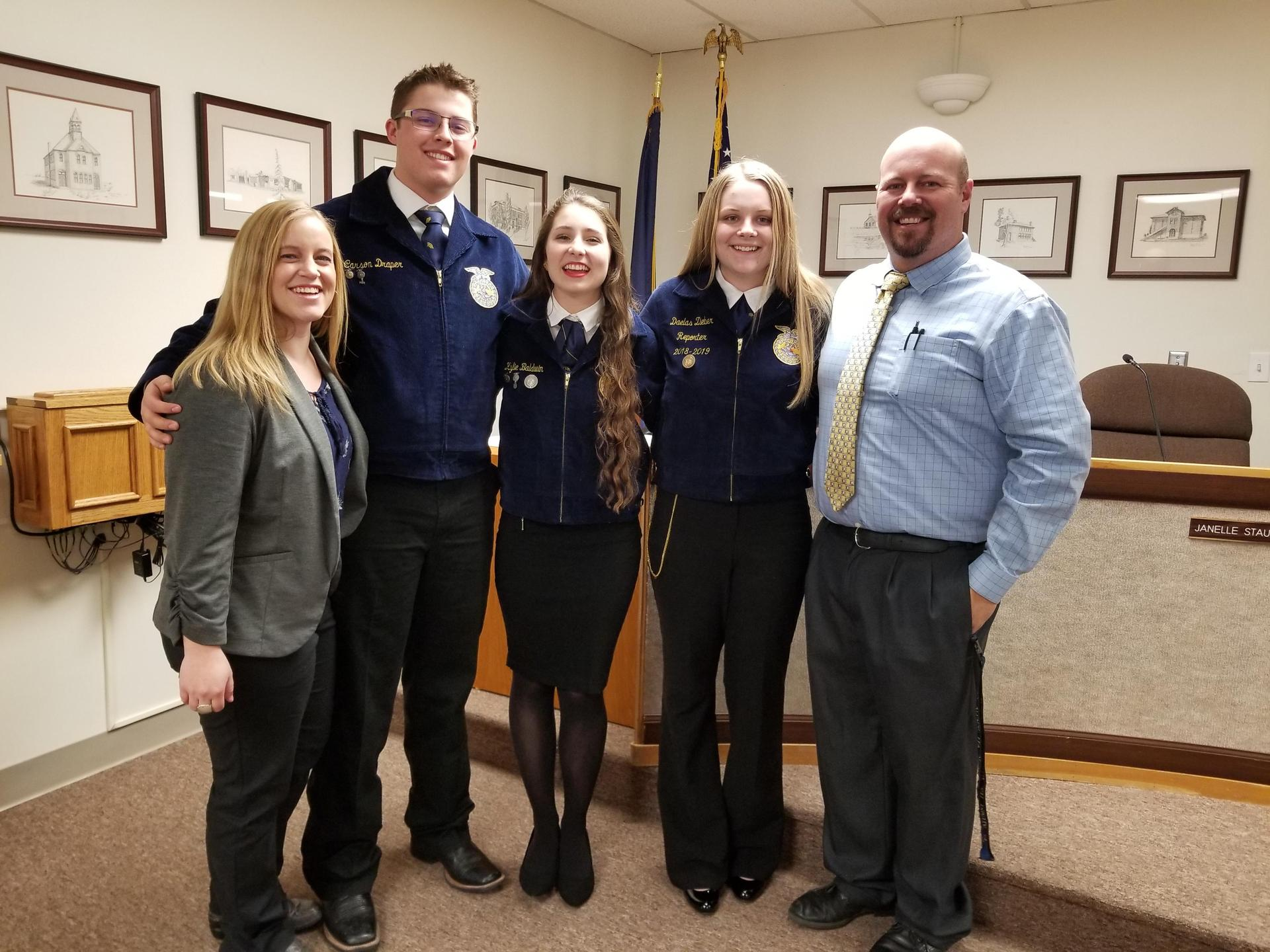 FFA student leaders and advisors pose before the meeting.