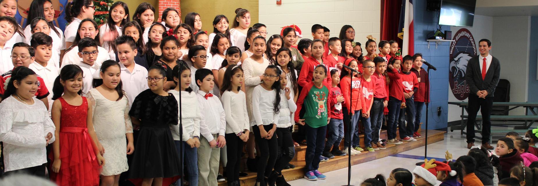 Mr. Gonzalez, music teacher with Choir kids