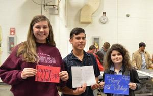 students with christmas cards