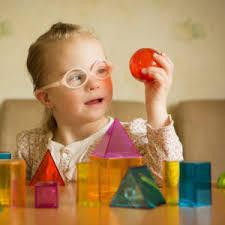 Female child looking at a building block
