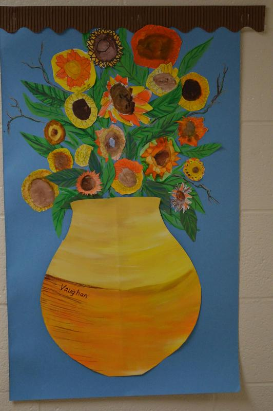 A picture of a vase with student-created sunflowers.
