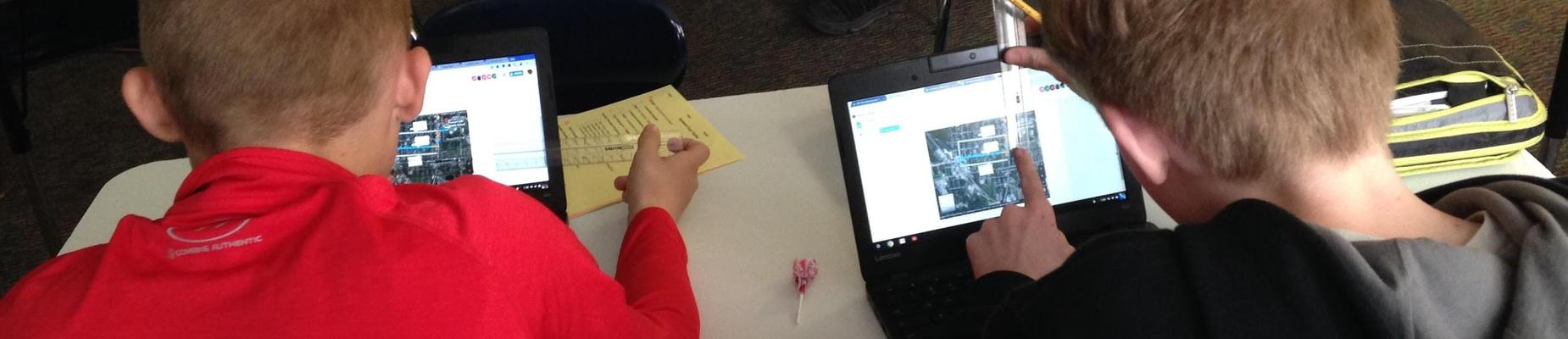 Students using Chromebooks to determine distance