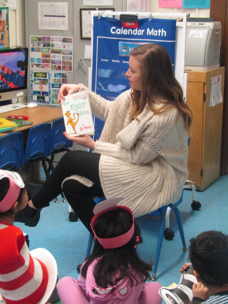 teacher reading dr. seuss foot book to pre-k class