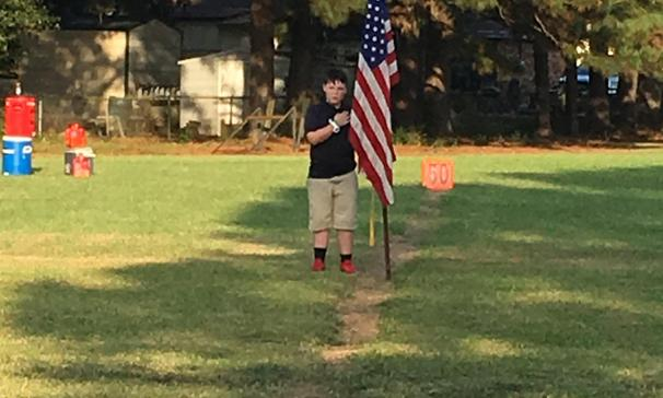 Nathaniel held the flag during the National Anthem.