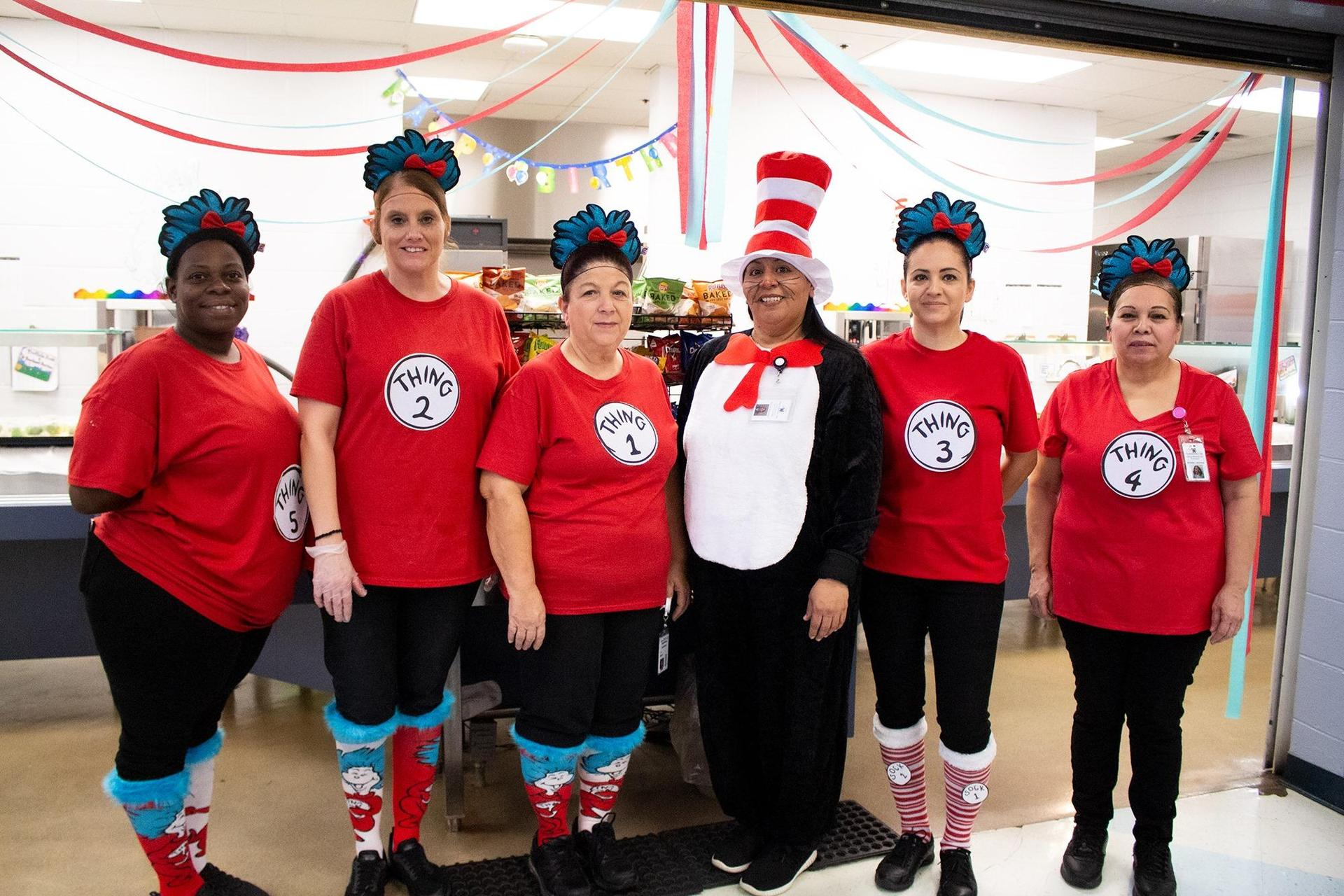 5 ladies dressed up as Cat in the Hat and Thing for Dr. Seuss birthday