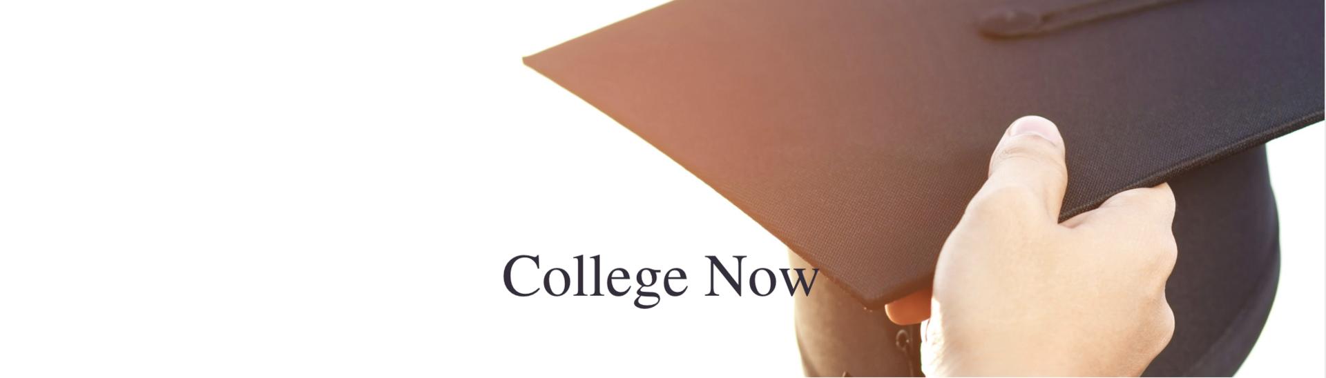 Hand holding a graduation cap