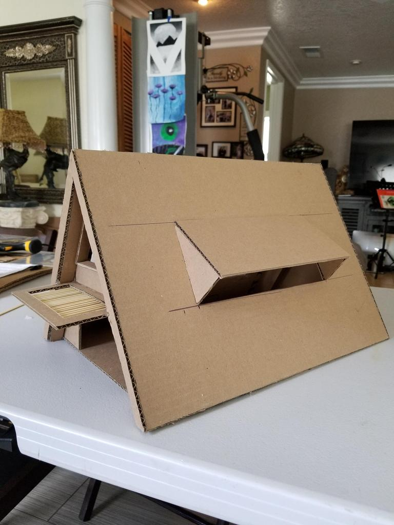 A frame house made out of cardboard
