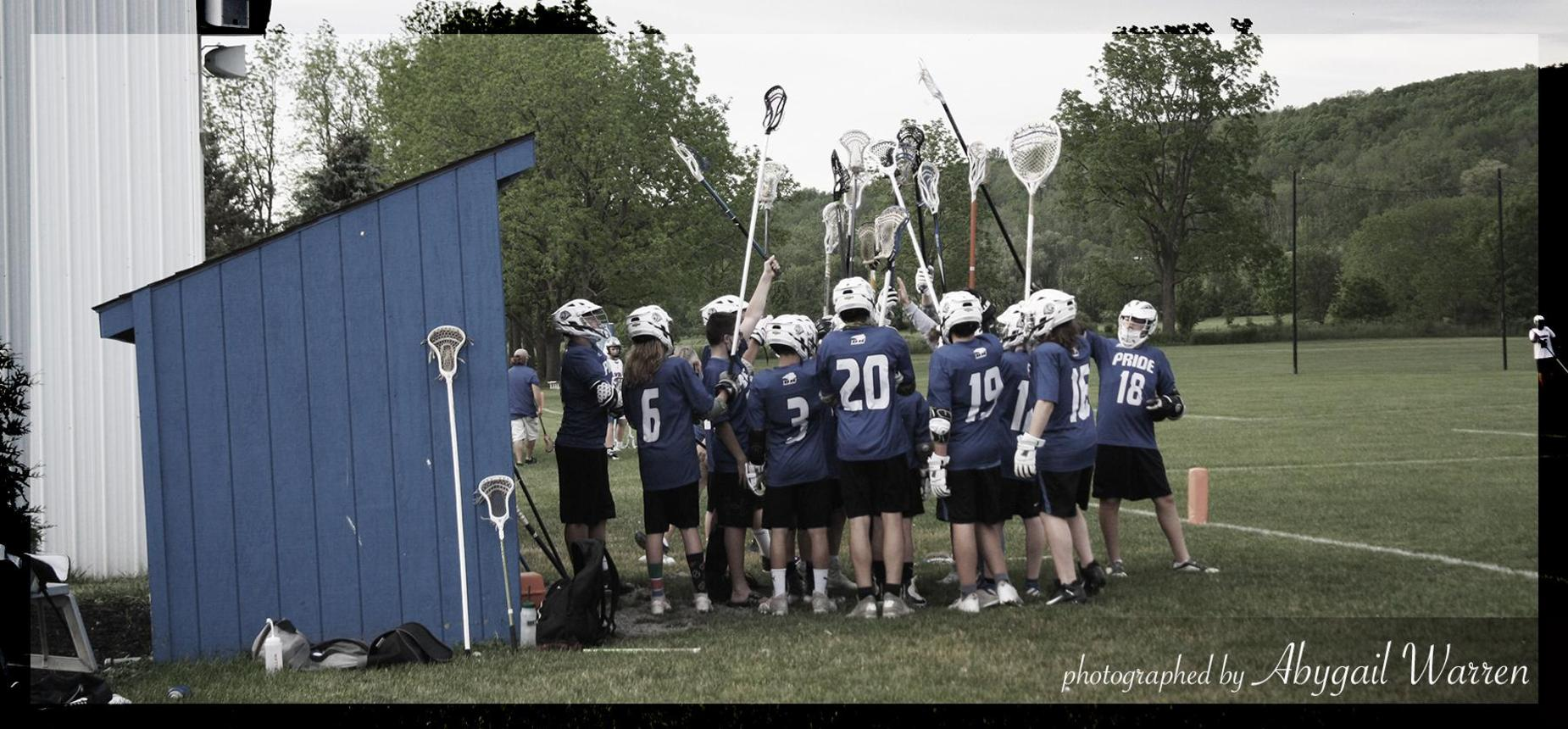HCS lacrosse players by dugout