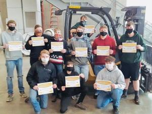 Students holding OSHA certifications