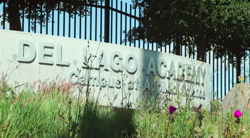 Image of DLA sign in front of school