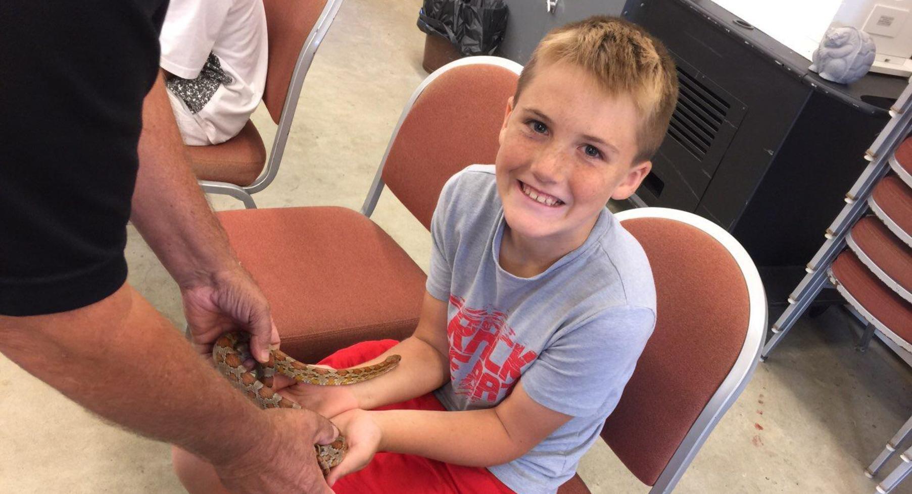 Student holding snake