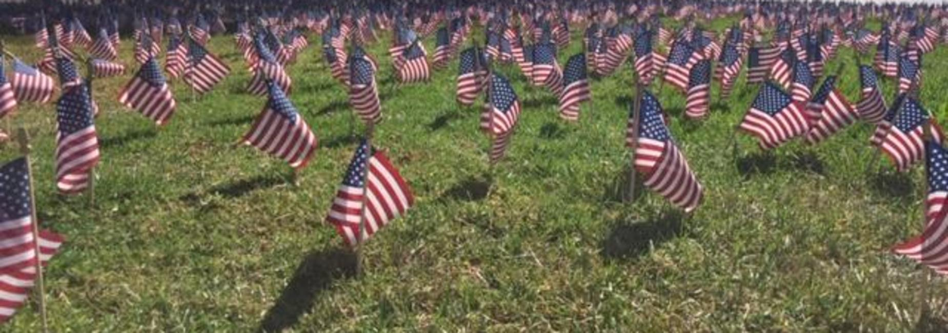 Photo of hundreds of USA flags in the ground in front of Westmont campus in honor of the 9/11 victims