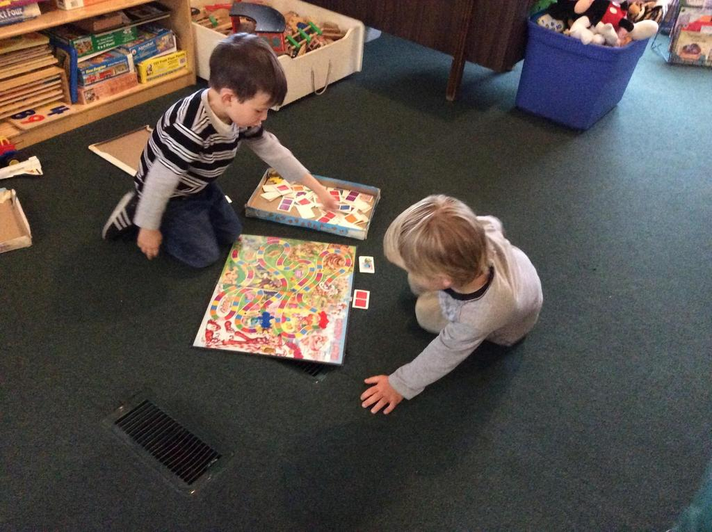 two kids playing a board game