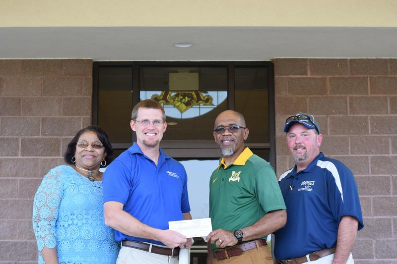 Southwest Distributors donate to Partners in Education (PIE).
