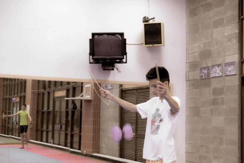 HWIS graduate studying abroad in Taiwan plays in a gymnasium