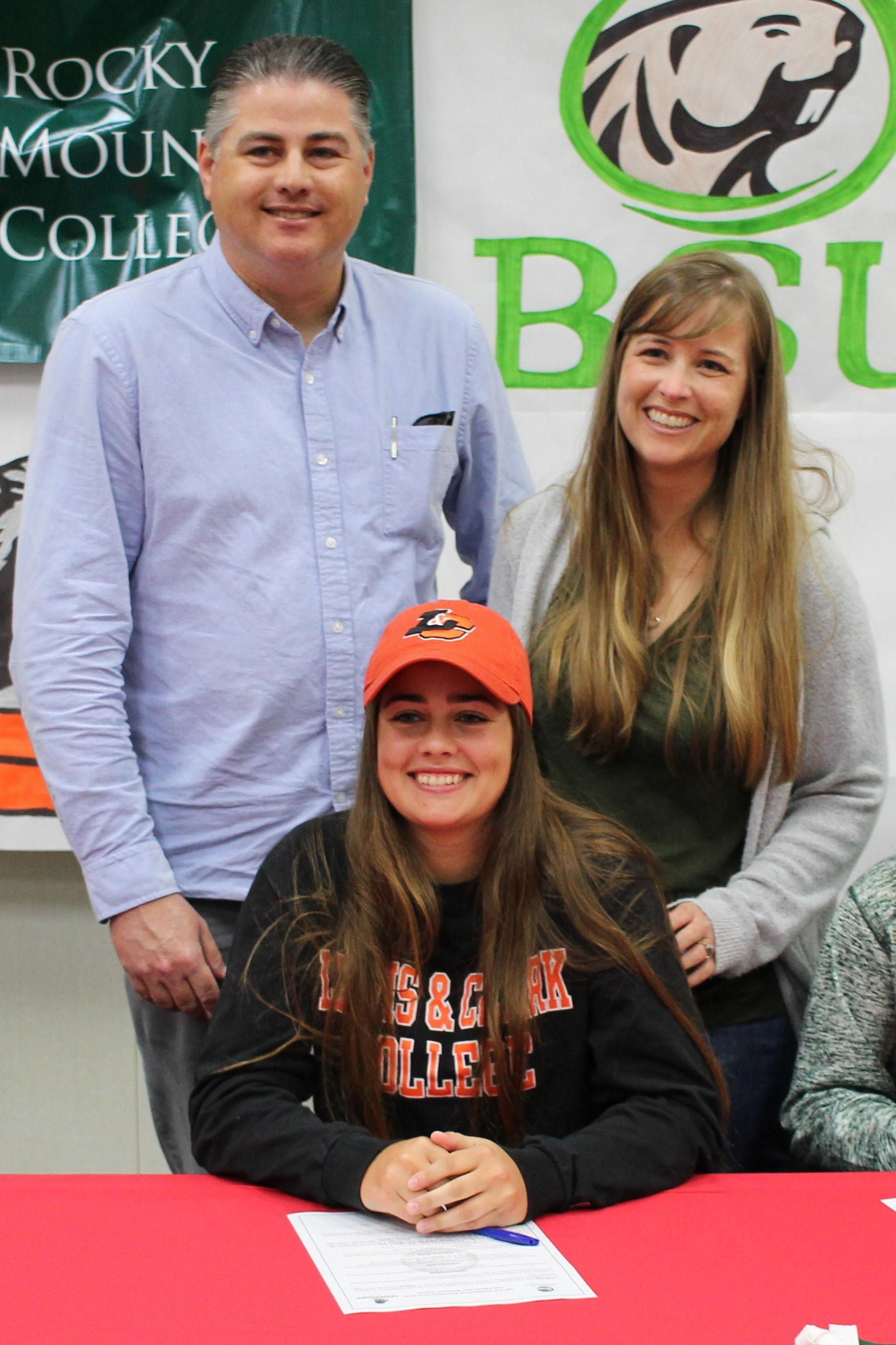 Kylie Hill signs her National Letter of Intent to Attend Lewis & Clark University in Portland, Oregon to play Softball.