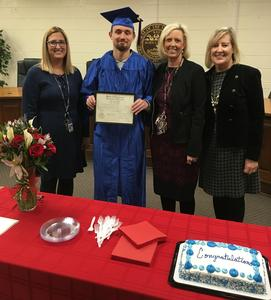 Jesse Watson graduates from Riverside Academy.