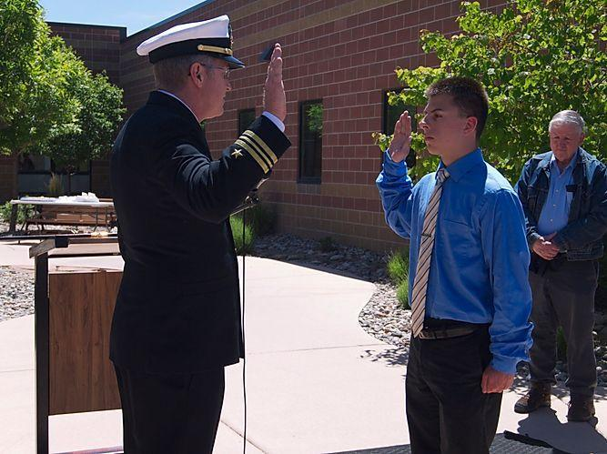 Caprock Graduate Jonah K. being inducted into the Marine Corps.
