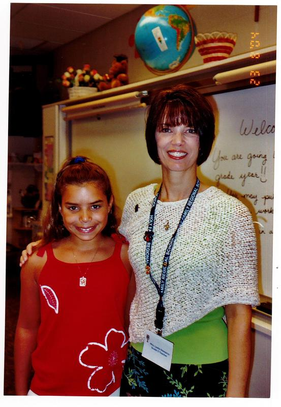 Alex pic 5th grade with Mrs. Demarco.jpeg