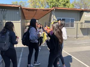 Students giving other students flowers