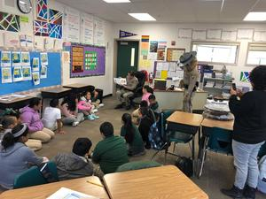 California Highway Patrol Officer reading to a group of students, image 3