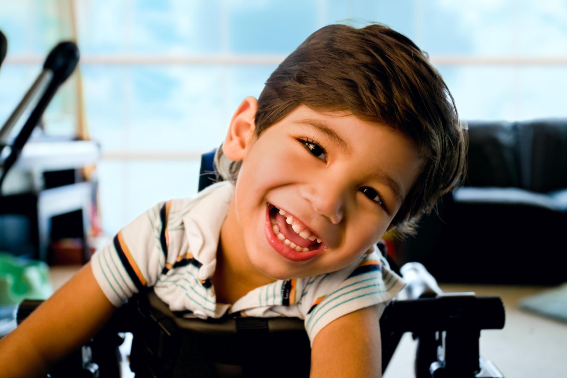 smiling boy in wheeled walker
