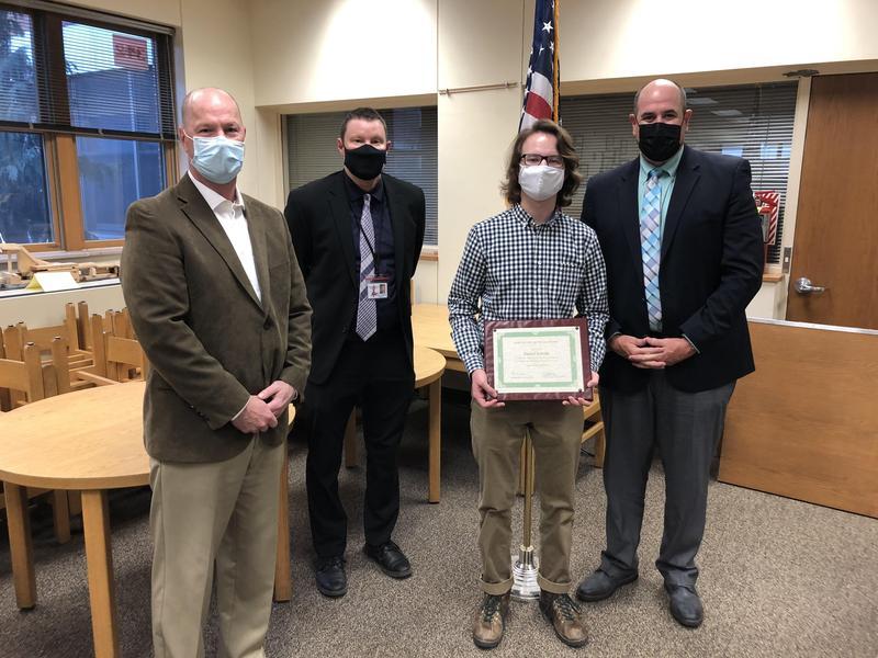 Image of Daniel receiving an award