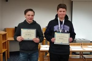 Tyler Vanderlugt and Jacob Robbins hold up their certificates.