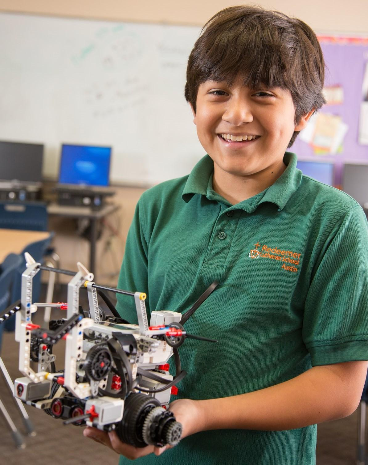 Student holding robot