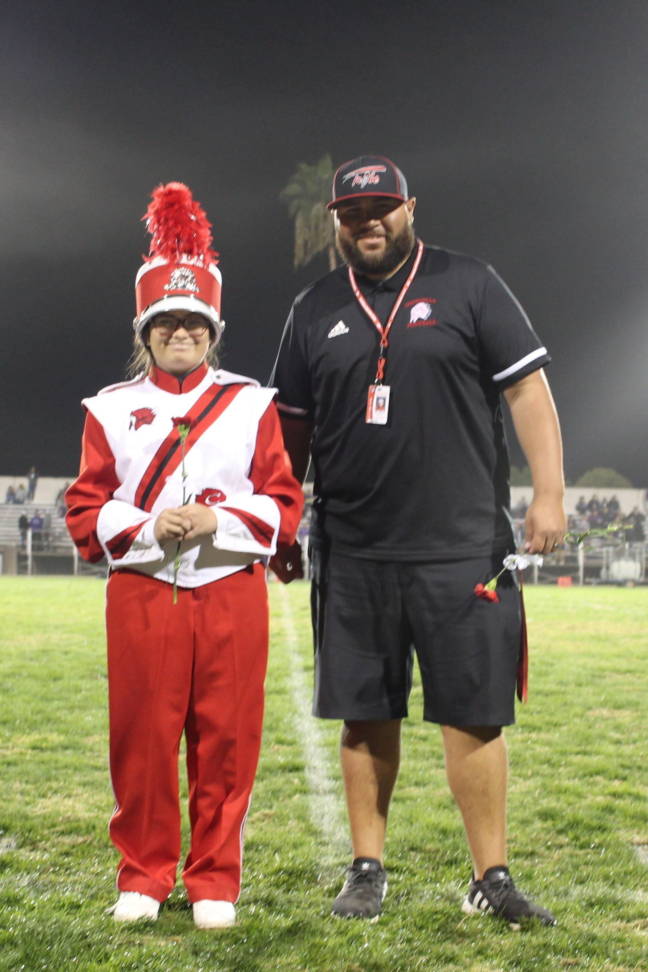 Senior band member Jamie Borbon and her escort.