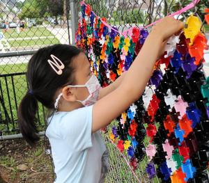 Lincoln student works on playground mosaic.