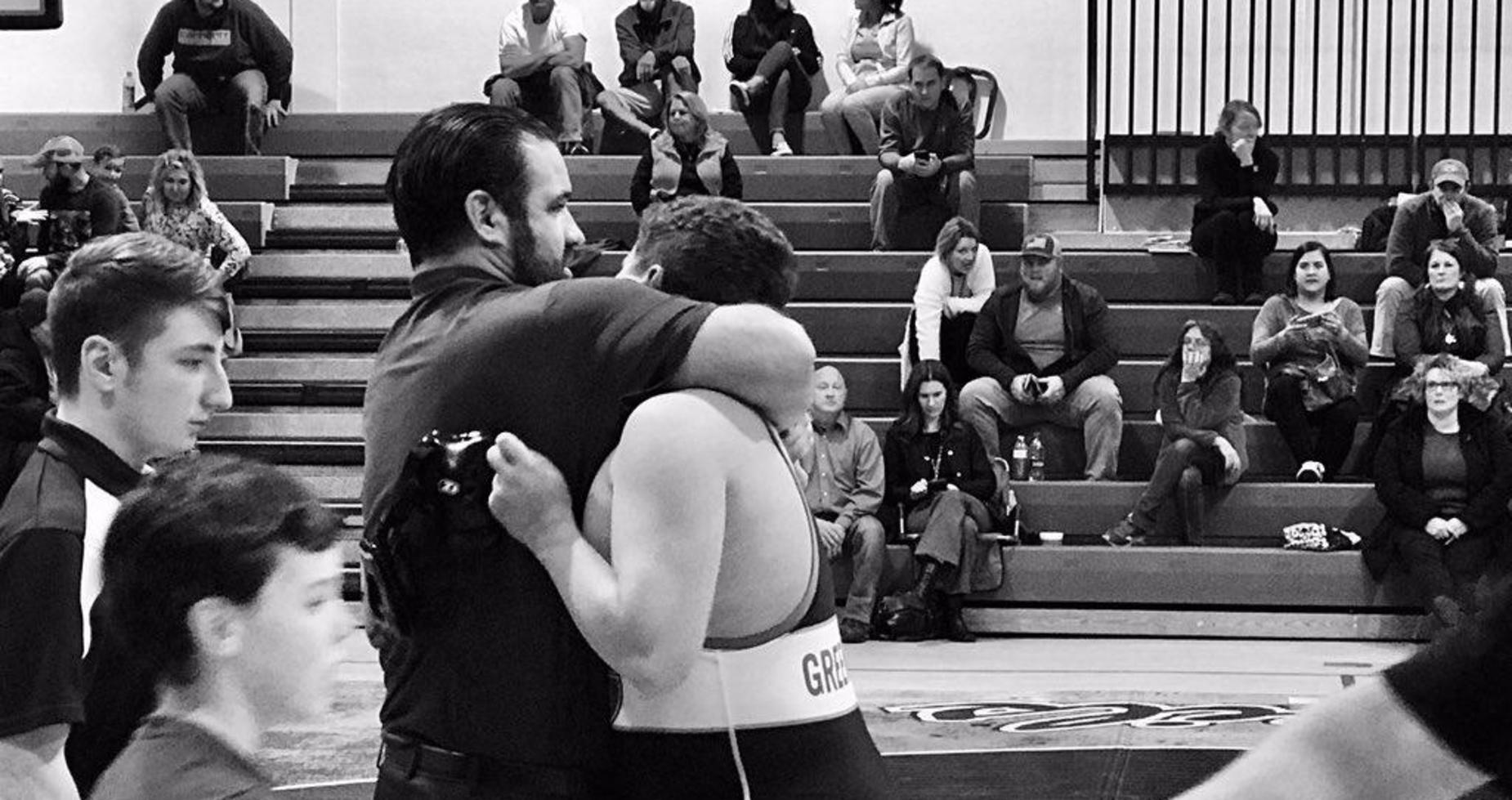 a picture of a wrestler and coach