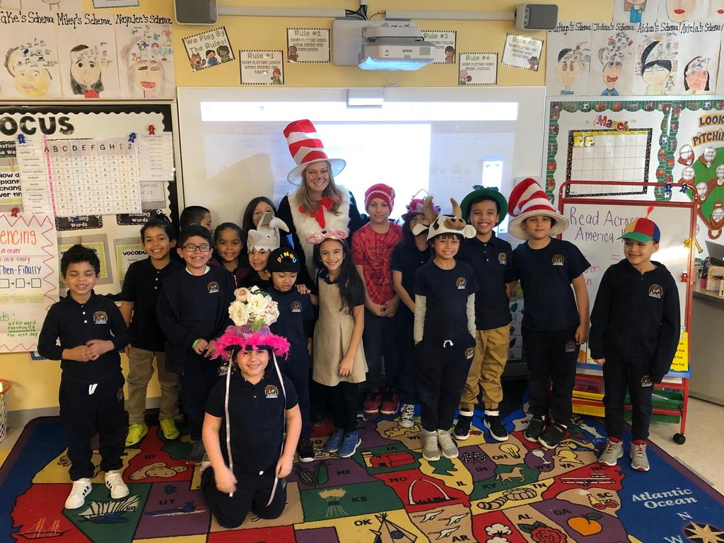 Teacher dressed as the cat in the hat visiting a classroom