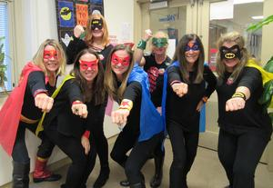 Photo of RIS staff dressed as superheroes for Halloween.