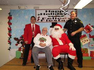 principal Celebrano, Mr. & Mrs. Claus, and school police officer