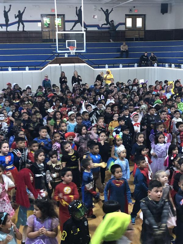 students dressed in costume in the gym