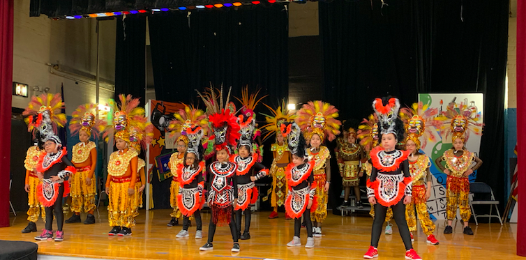 Image of Dance Club Dress Rehearsal with students in costume on stage
