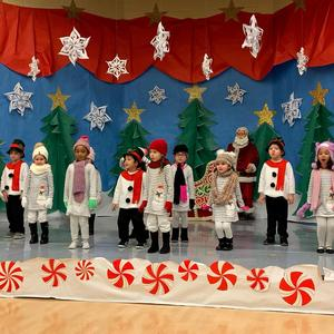 Winter wonderland group singing on stage