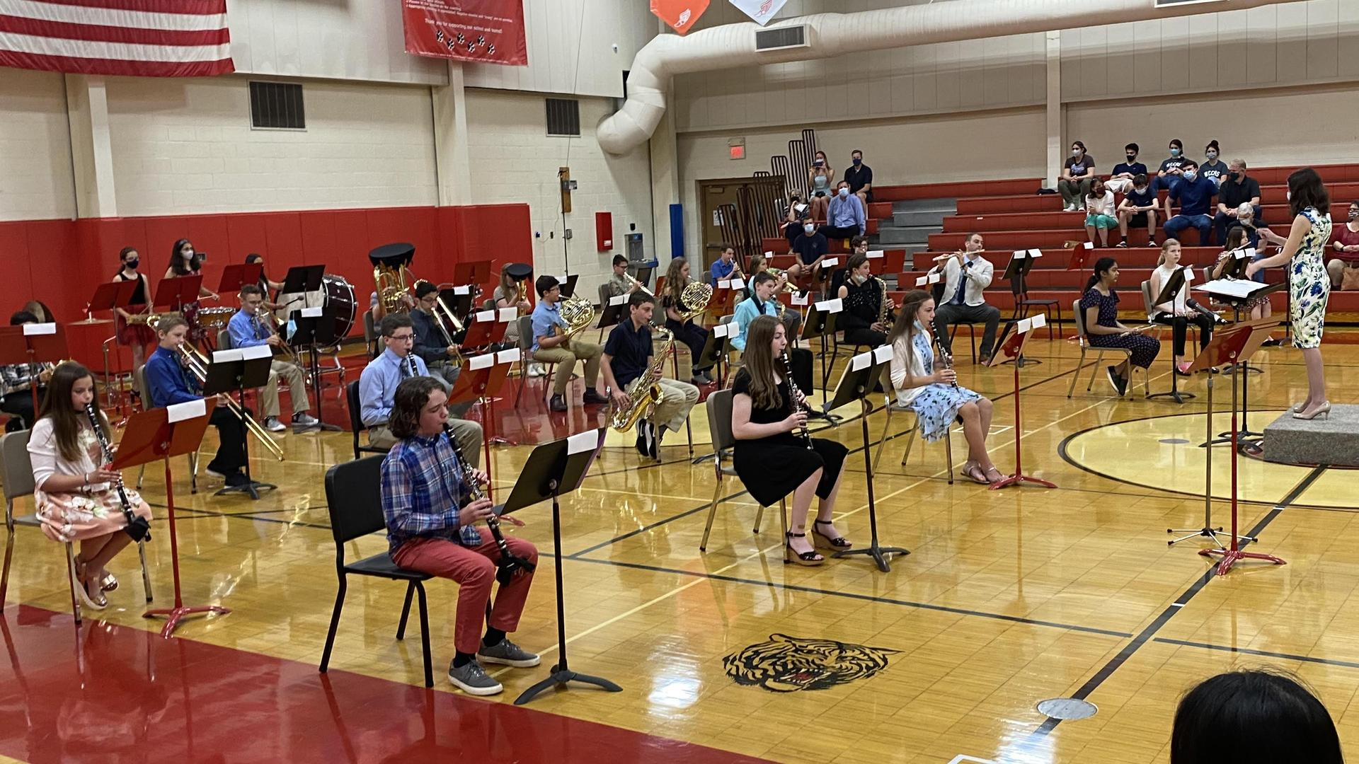 A group of band students playing instruments in the Benjamin gym