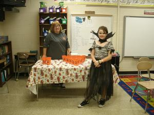 Mrs. Wheeler and a 5th grade student at a game table.
