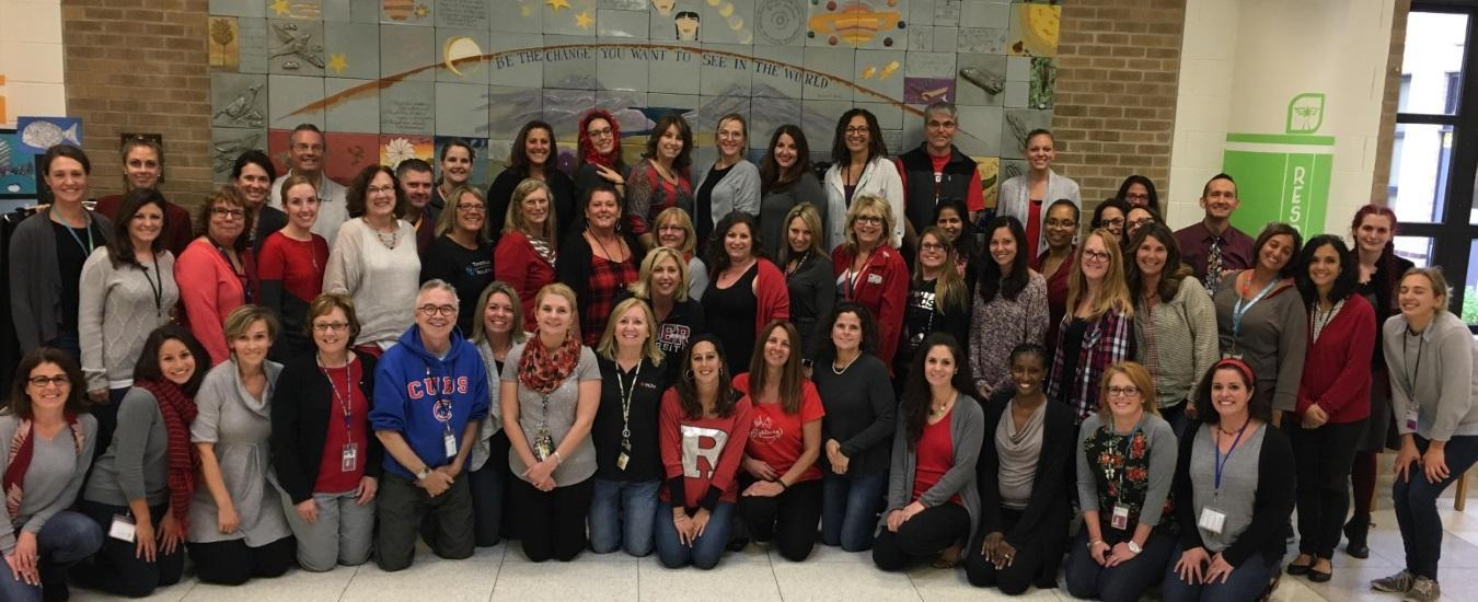 TMS staff wearing red, grey and black in support for our partner school, Las Americas Middle School