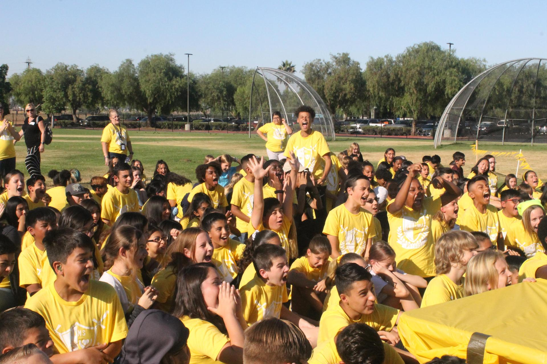 kids in yellow shirts