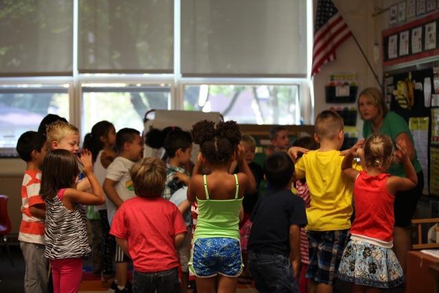 kids in class by teacher