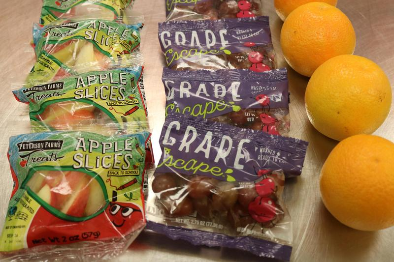 Photo of fruits- apple slices, grapes and oranges
