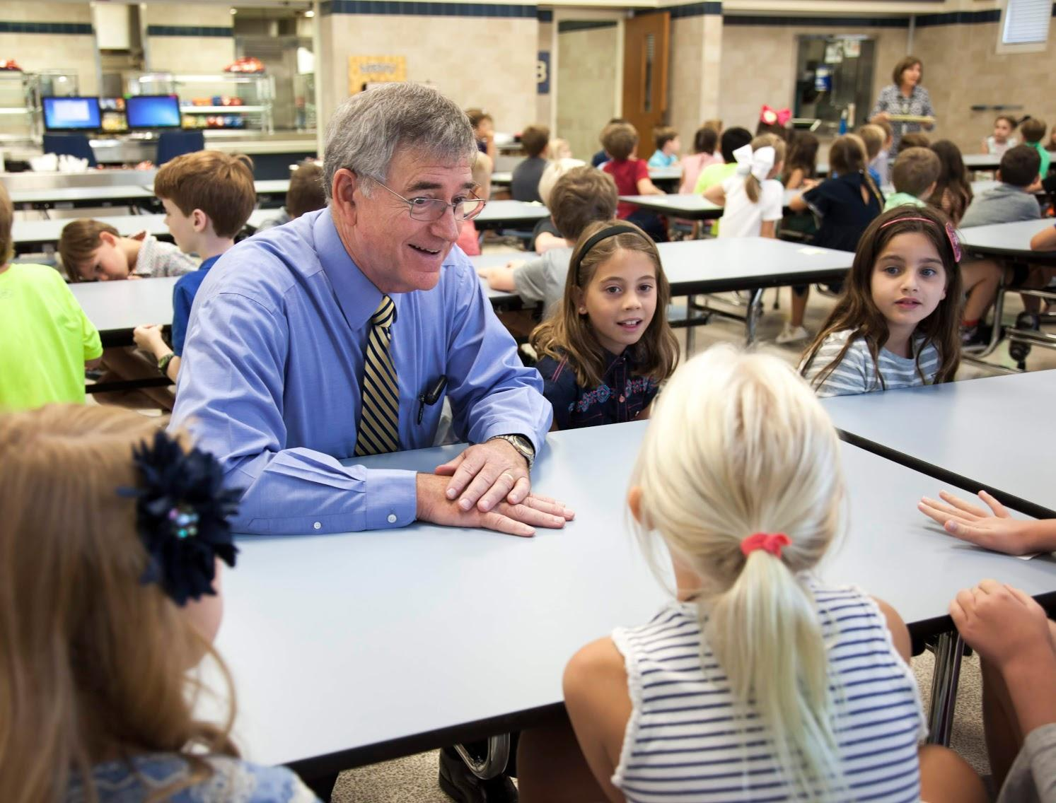 Dr. Trigg having lunch with elementary students in the cafeteria